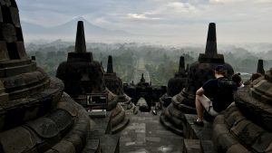 sunrise between stupas on borobudur temple